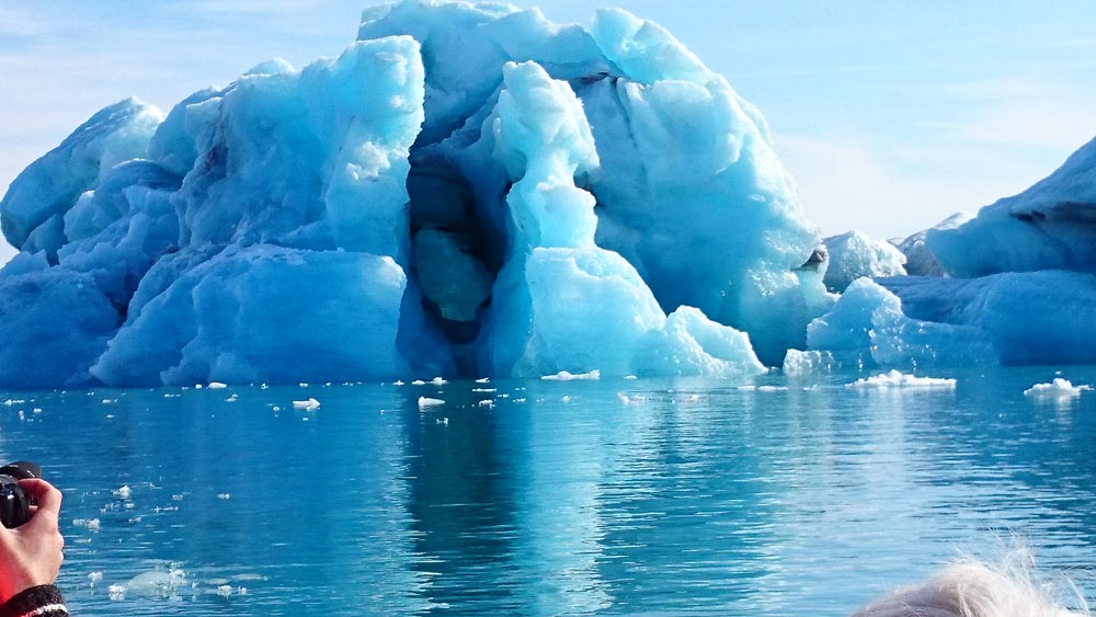 Iceberg floating Jokulsarlon Glacier lagoon blue-ice sunny day