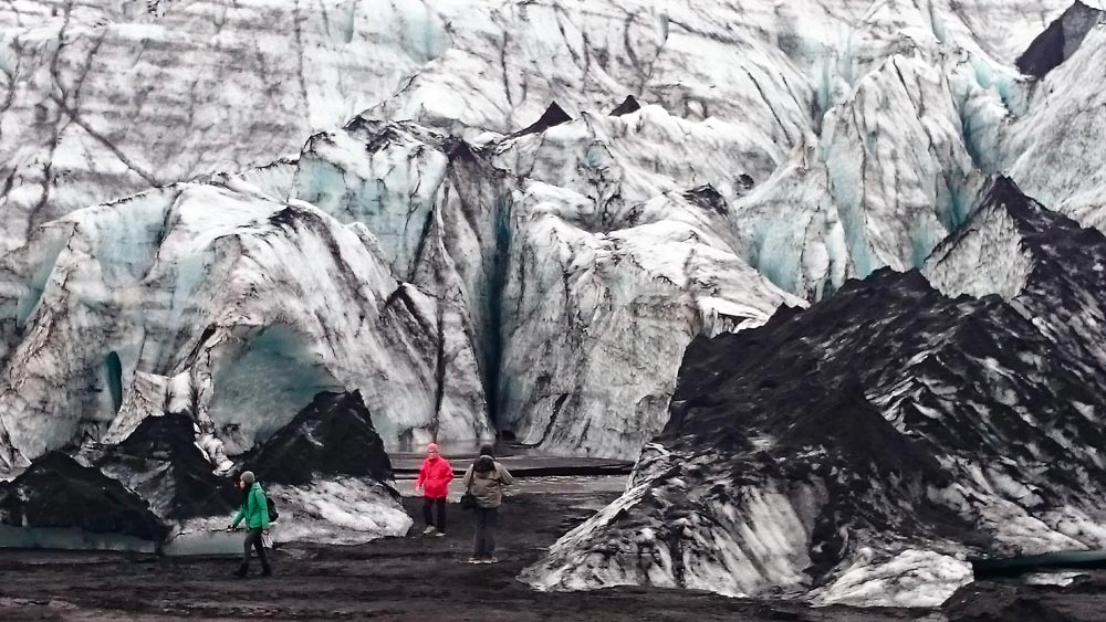 The glacier Solheimajokull with black sand volcanic ash